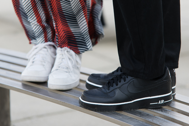 Details: Nike white and black sneakers by Inès Monnet