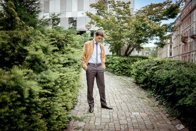 Nicolas wearing a Carpasus shirt, a vintage suede leather jacket, Avant Première suit pants, a COS tie and Zara shoes