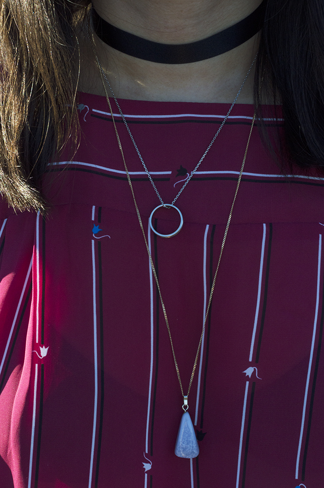 Details: Black choker, ring necklace and stone necklace