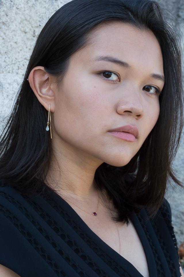 Portrait of Claire wearing Lylan jewellery