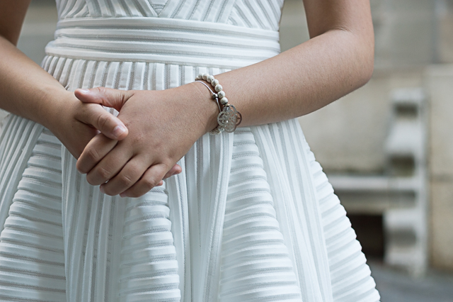 Details: white bracelets by Midnight Blossom and Manidou