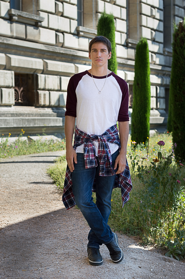 Nicolas wearing a raglan shirt by Forever 21, jeans by Levi's, plaid shirt by Uniqlo, Nike sneakers