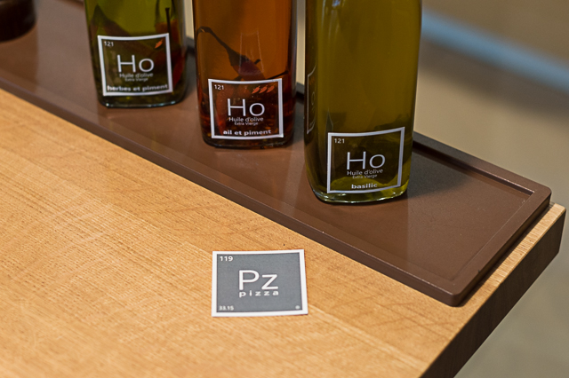 Homemade aromatised olive oils at Pz Pizza in Lausanne