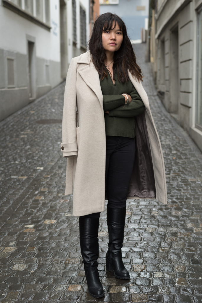 Claire wearing a Caroll coat, a Sandro sweater, H&M jeans and Graceland boots