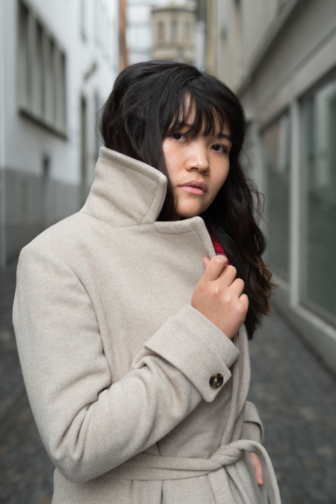 Portrait of Claire wearing a Caroll coat