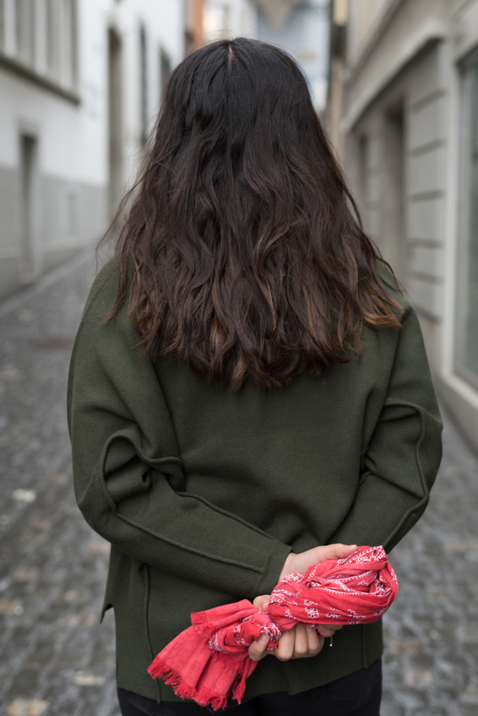 Claire from behind, wearing a Sandro sweater