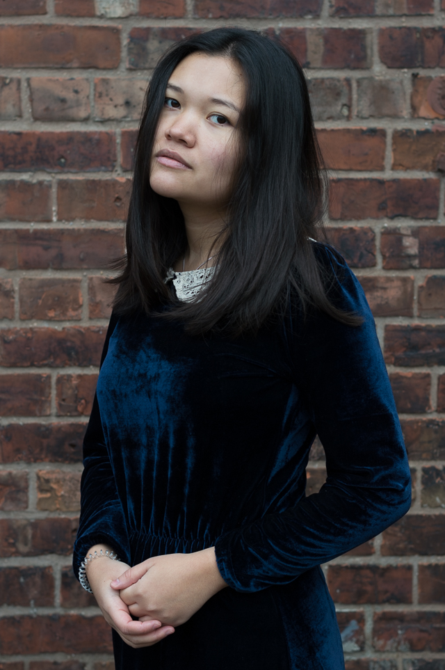 Claire in Manchester, wearing a vintage blue velvet dress