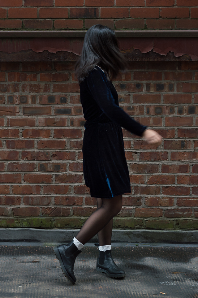 Claire in Manchester, wearing a vintage blue velvet dress and Dr Martens chelsea boots