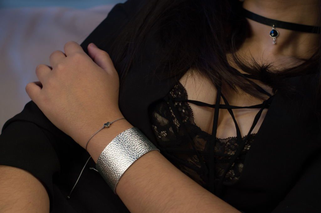 Details: silver cuff and heart bracelet, and onyx choker