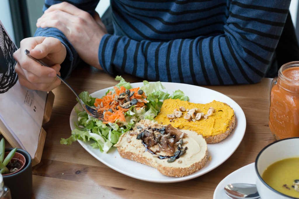 Toasts garnished with hummus and onions, and squash purée with hazelnuts