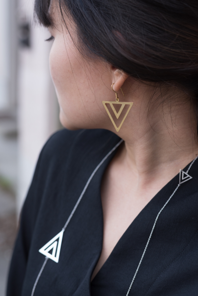 Details: pyramid earrings and necklace by Shaï