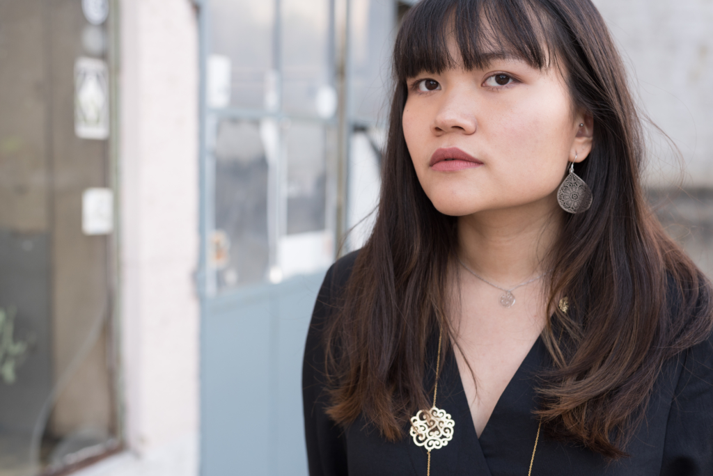 Portrait of Claire Ketterer wearing Shaï jewellery