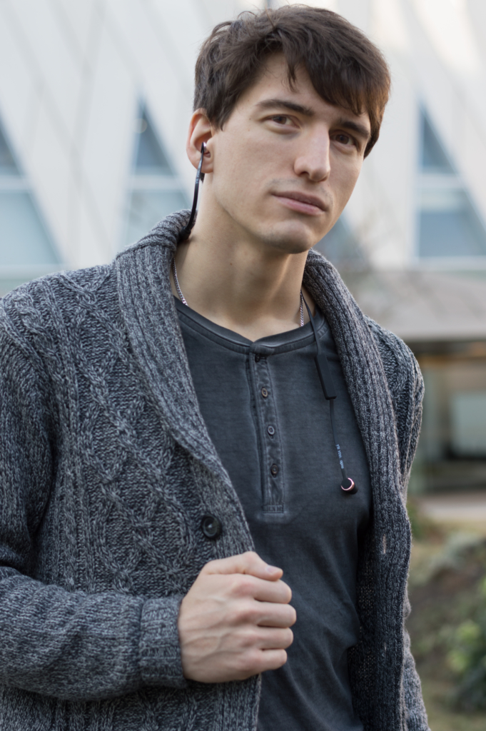 Portrait of Nicolas wearing the VASA BLÅ earphones by Sudio Sweden