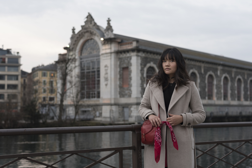 Claire in Geneva, wearing a Caroll coat, a & other stories sweater and a red Longchamp bag for Valentine's Day