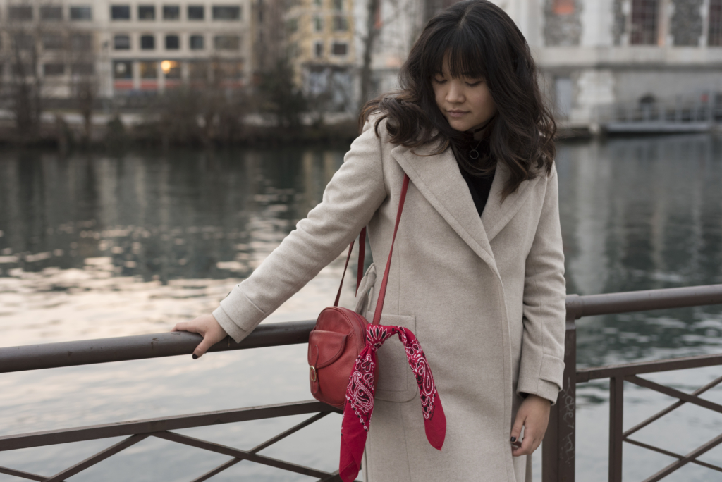 Claire wearing a Caroll coat, & other stories sweater and a red Longchamp bag