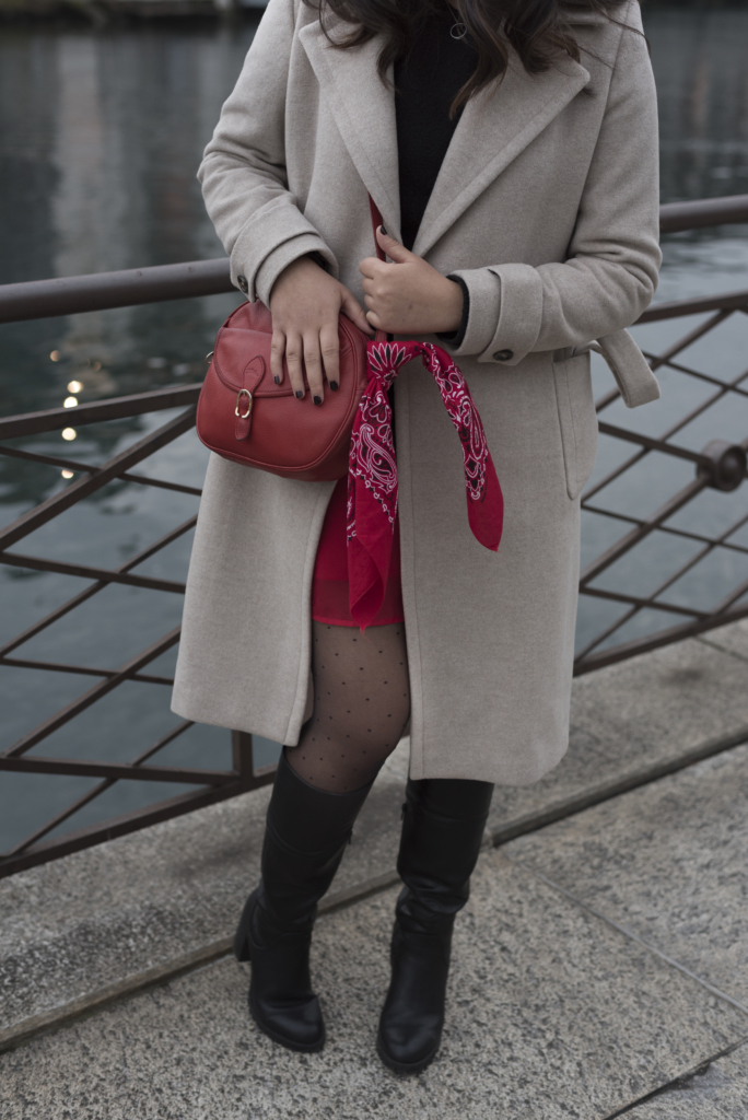 Details: Caroll coat, & other stories sweater, a red dress, a red Longchamp bag, polka dots tights and Graceland boots