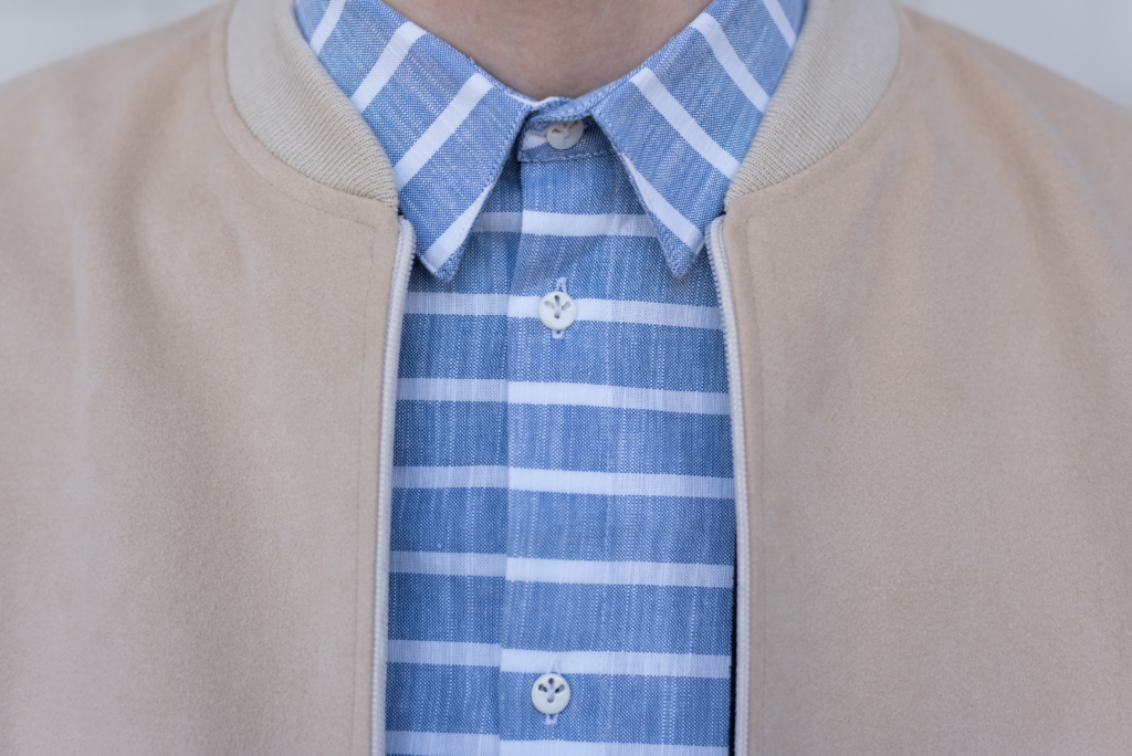 Details: collars of the bomber and striped shirt by Solstice
