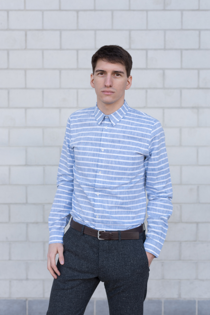 Nicolas wearing a striped shirt and woollen pants by Solstice