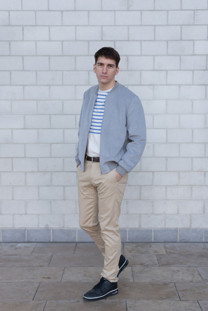 Nicolas wearing a bomber, a striped t-shirt and chino pants by Solstice