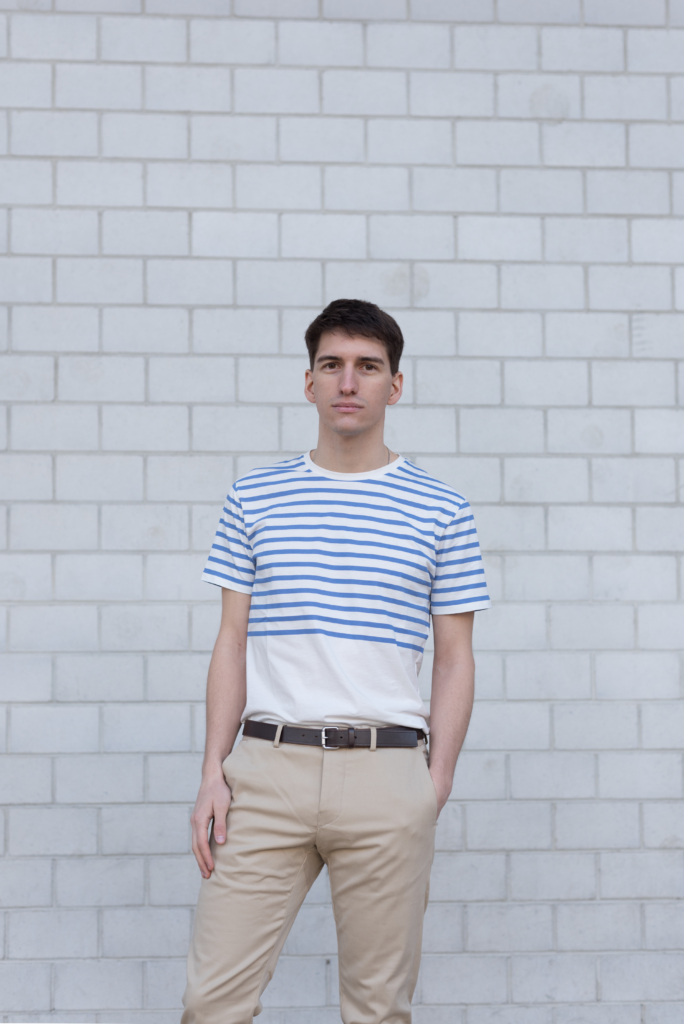 Nicolas wearing a striped t-shirt and chino pants by Solstice