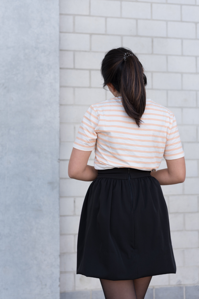 Claire wearing a t-shirt with peach stripes by Solstice and a handmade skirt