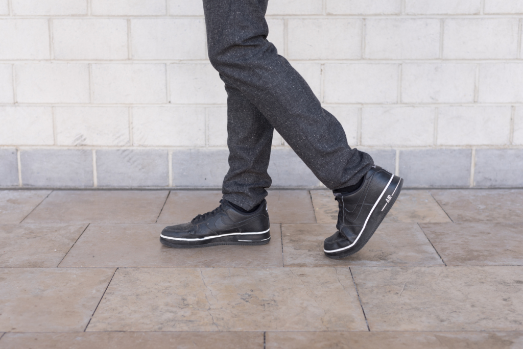 Details: grey woollen pants by Solstice and Nike sneakers
