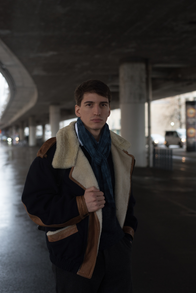 Nicolas wearing a vintage bomber and a Wrangler scarf
