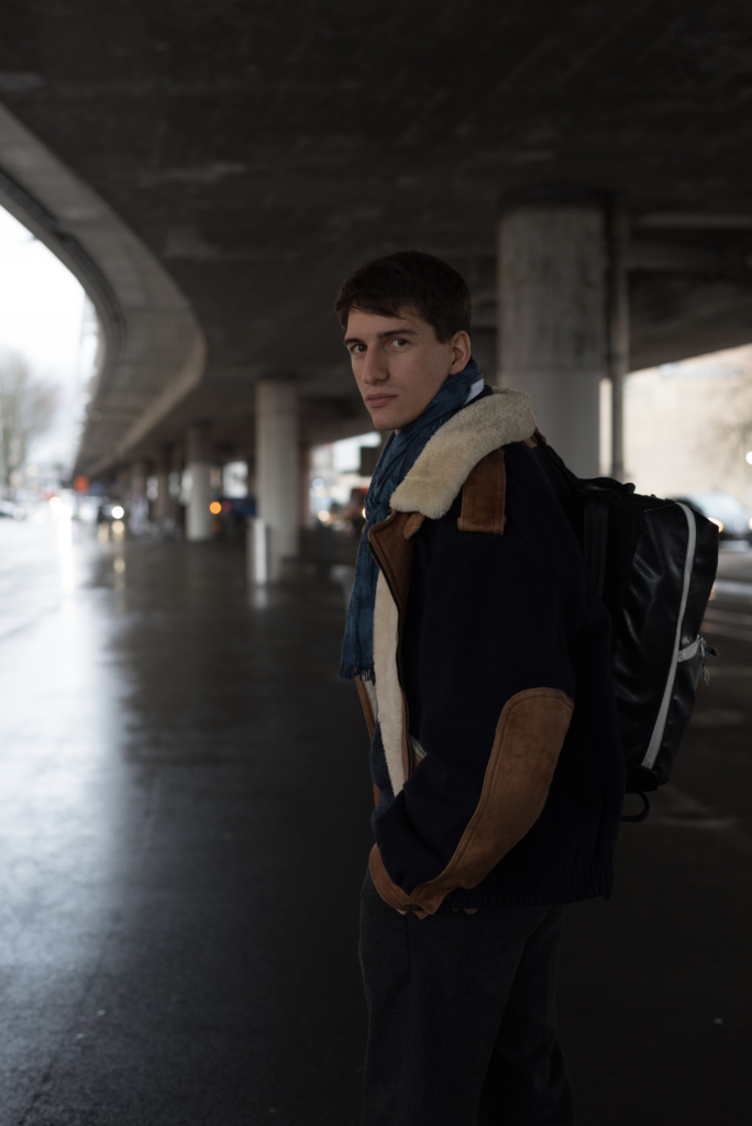 Nicolas Moser wearing a vintage bomber and a Freitag backpack