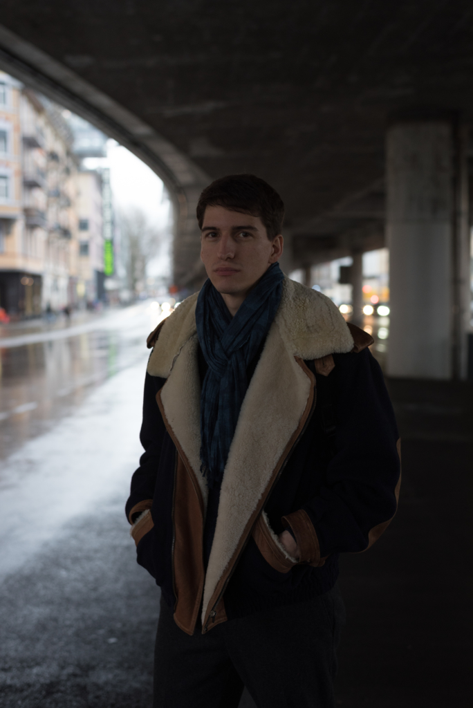 Nicolas Moser wearing a vintage jacket and a Wrangler scarf