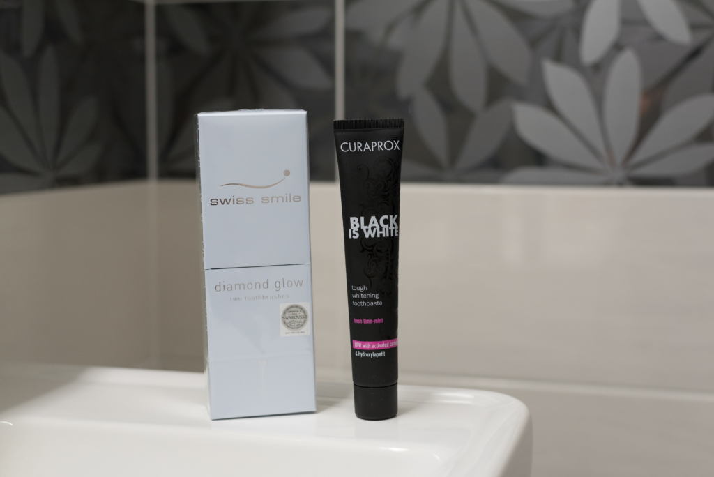 Black is White by Curaprox and toothbrushes by Swiss Smile