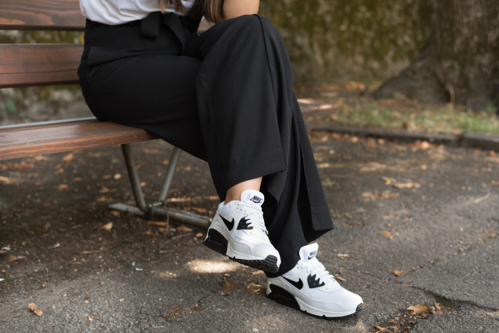 Details: COS black trousers and Nike Air Max sneakers