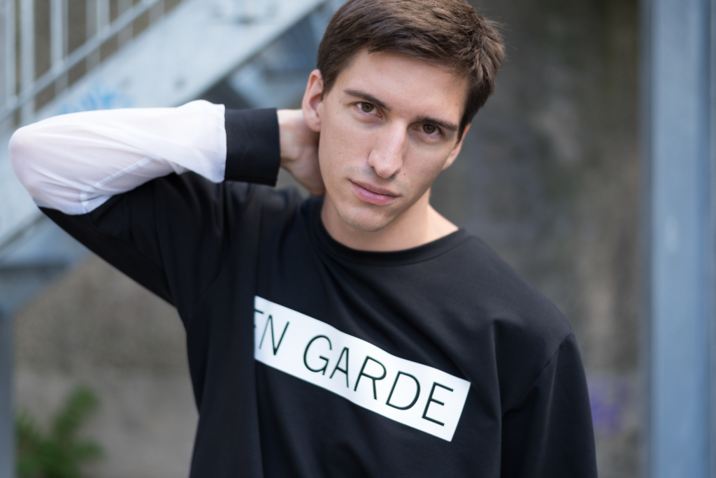 Nicolas wearing Joy + Grief's En Garde collection