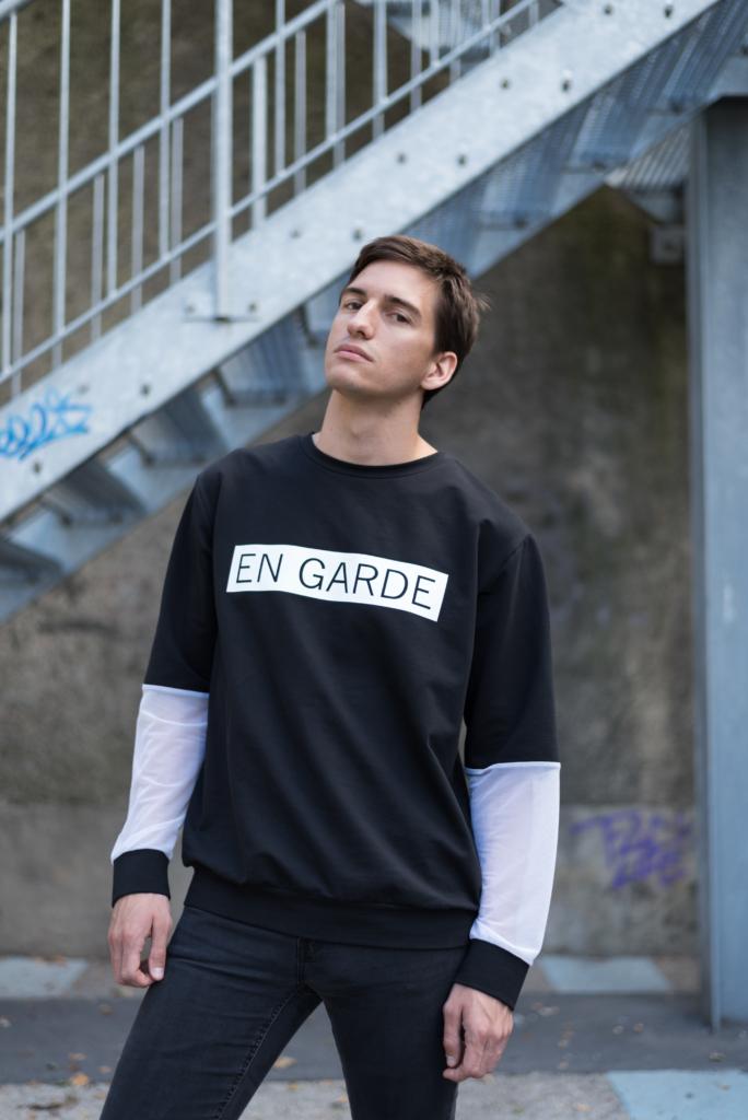 Nicolas Moser wearing Joy + Grief's En Garde collection