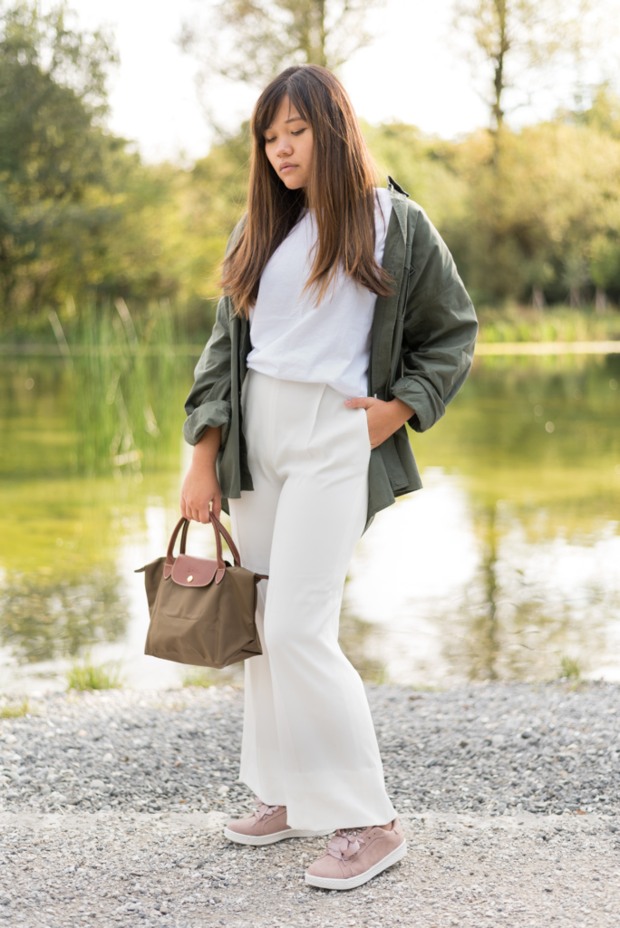 Claire Ketterer wearing a white and khaki look with blush Dosenbach shoes and her khaki Longchamp bag