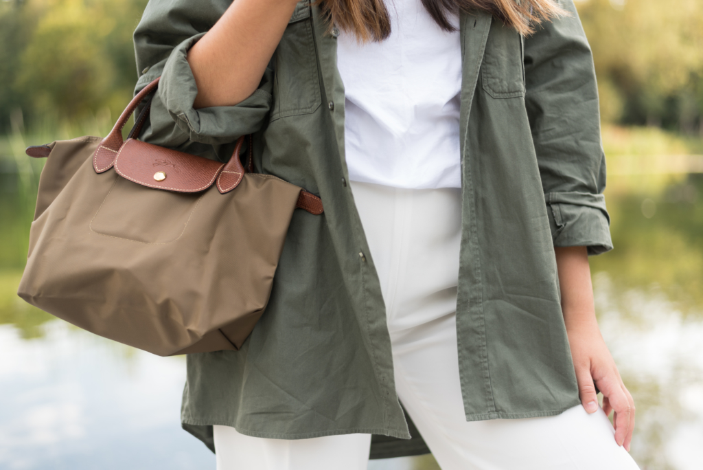 Claire Ketterer wearing a white and khaki look and her khaki Longchamp bag