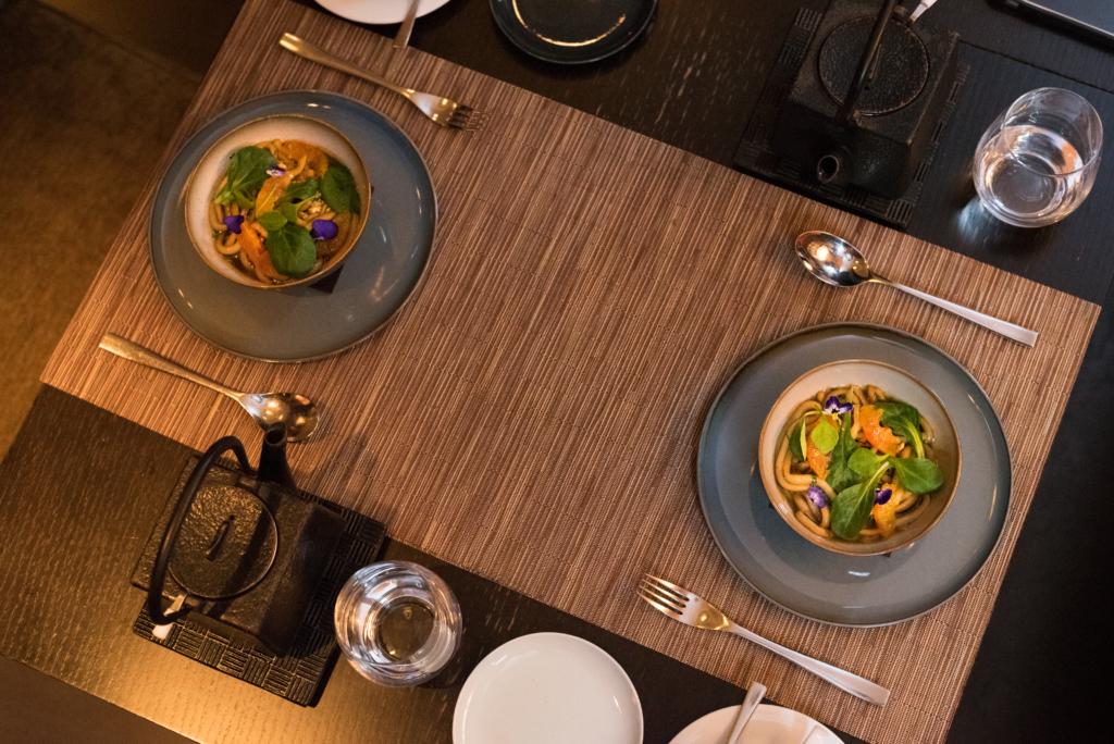 Udon noodles, lamb's lettuce, blood orange, peanuts and Japanese broth