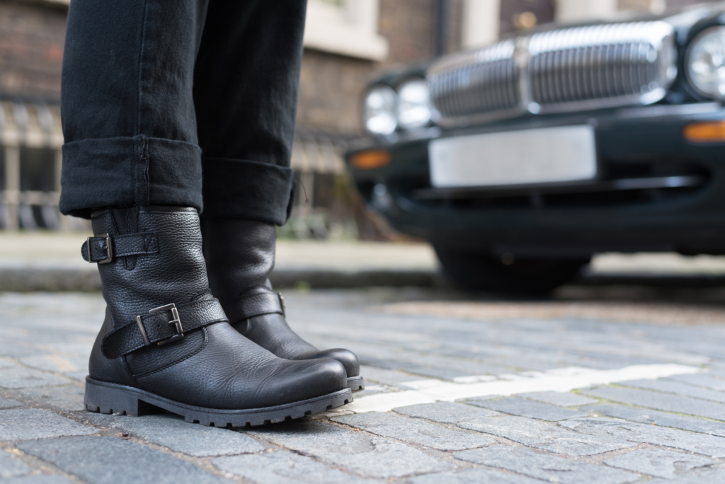 Claire wearing black biker boots by Dosenbach