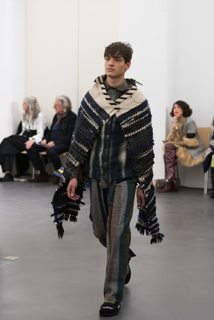 Model walking on the catwalk for Rafael Kouto at Mode Suisse Edition 13