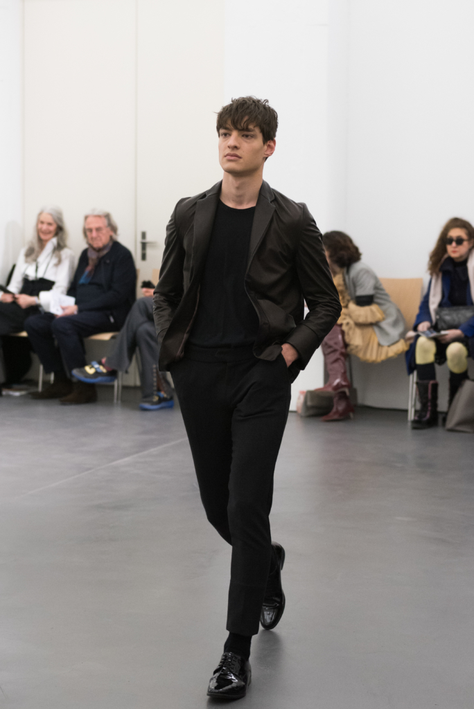 Model walking on the catwalk for Garnison at Mode Suisse Edition 13