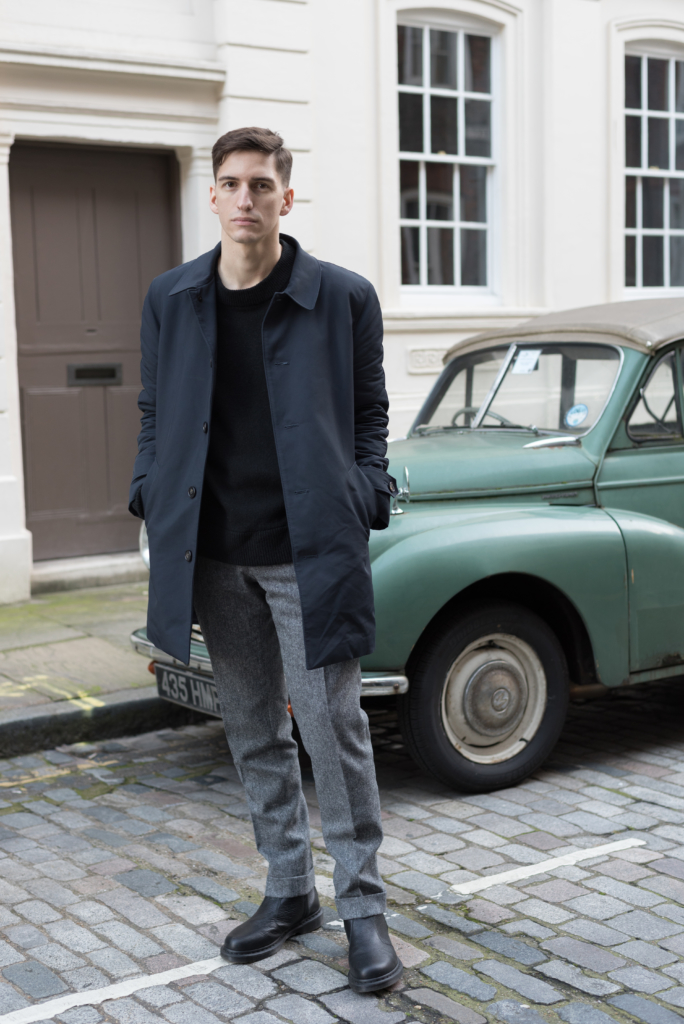 Nicolas Moser wearing a De Fursac coat and pants, an Allsaints sweater and Dr Martens Chelsea boots