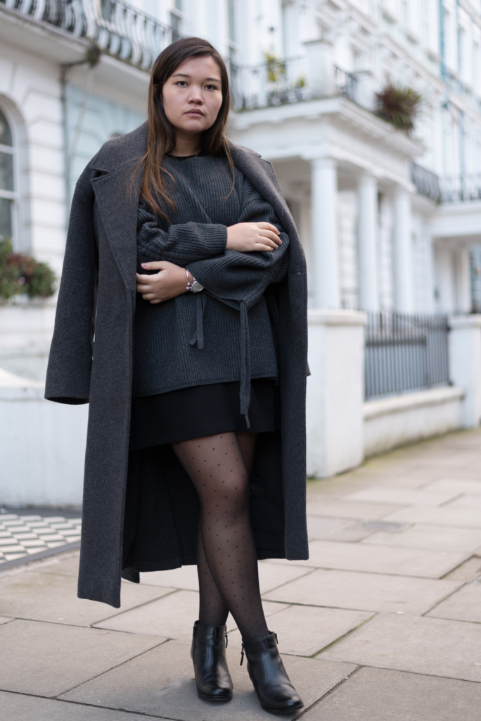 Claire wearing grey minimal tones in front of beautiful houses in Notting Hill
