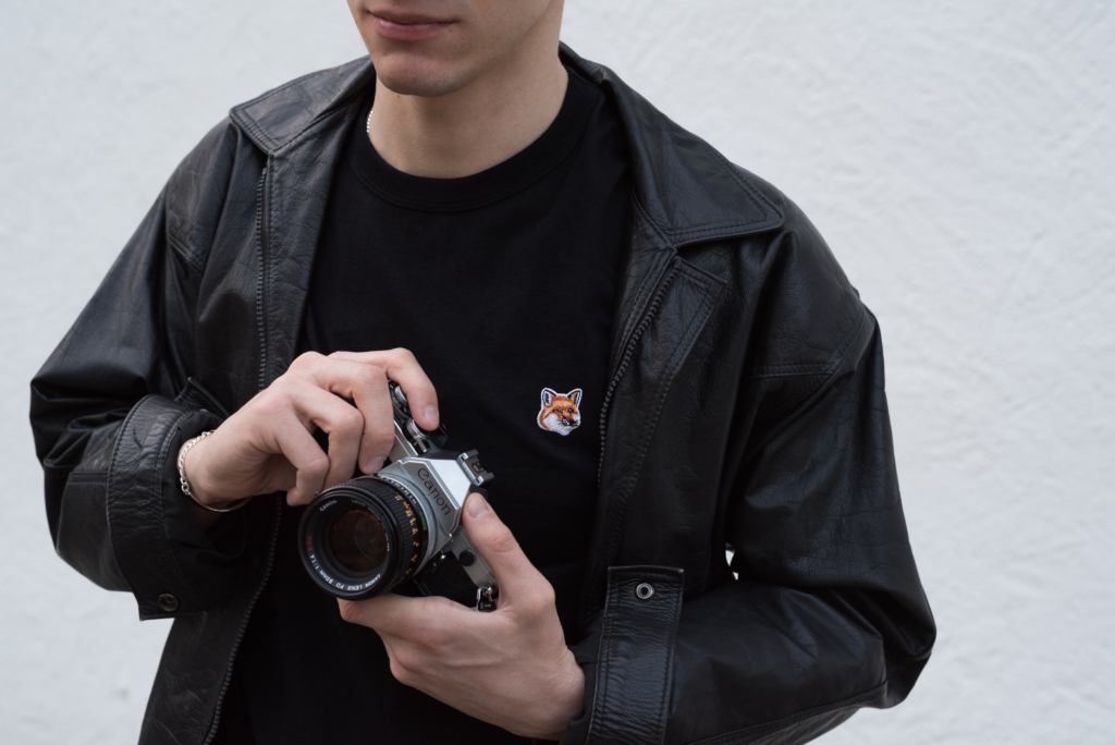 All black look with cool looking analogue camera