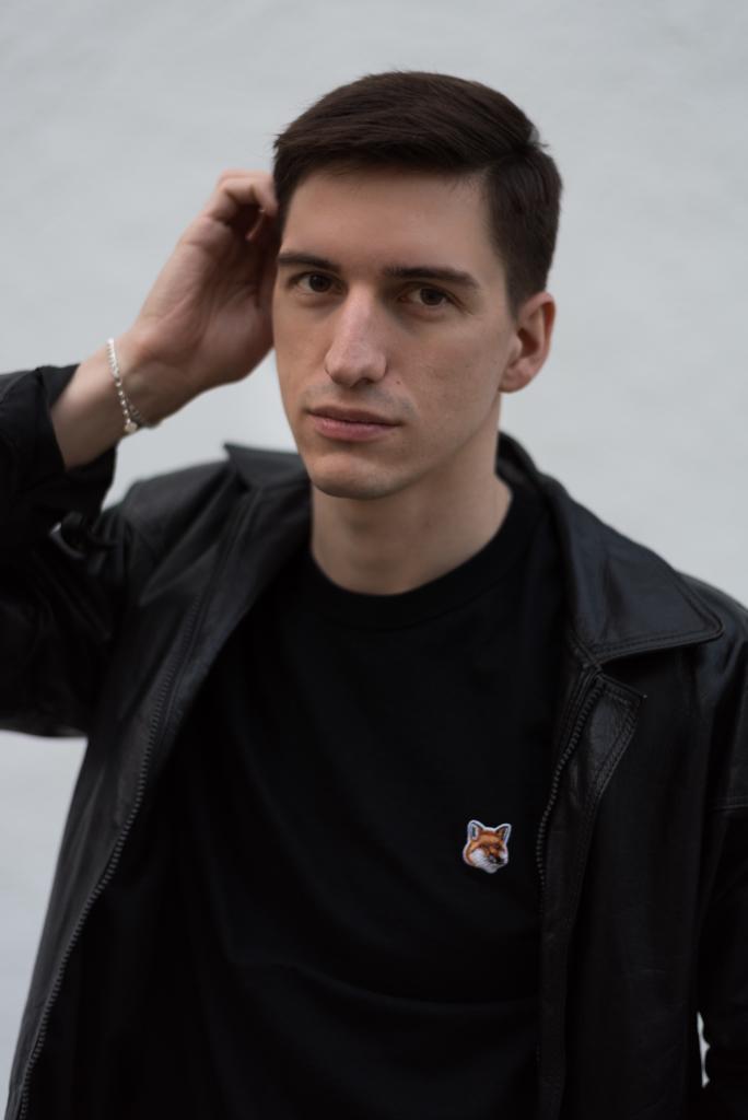 Portrait of Nicolas Moser wearing Maison Kitsuné