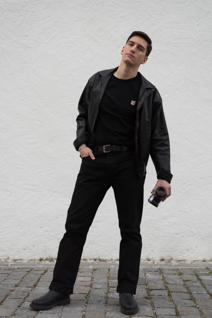 All black look with analogue camera featuring Nicolas Moser