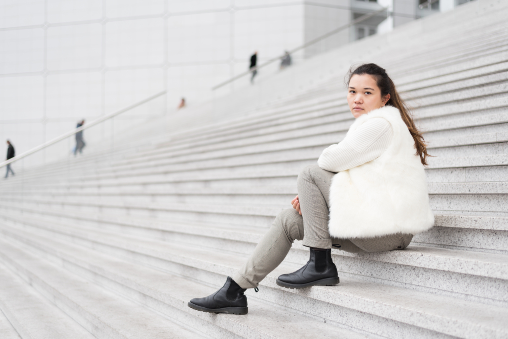 Claire in Paris wearing a faux fur vest, Chelsea boots by Dr Martens