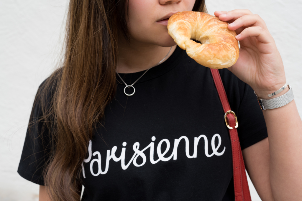 "Claire Ketterer wearing Maison Kitsuné's ""Parisienne"" and eating a croissant"