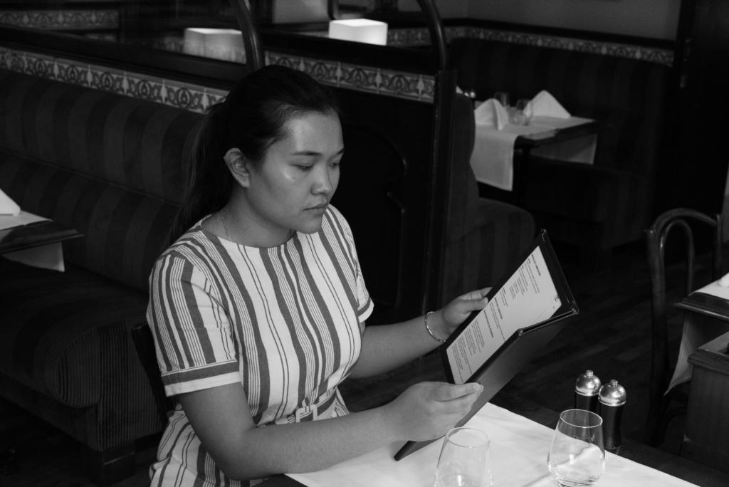 Claire Ketterer eating at Hôtel Tiffany