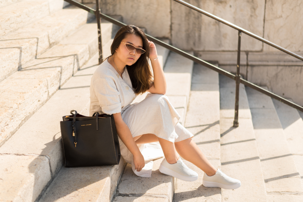 Claire Ketterer in Geneva, wearing a white linen dress