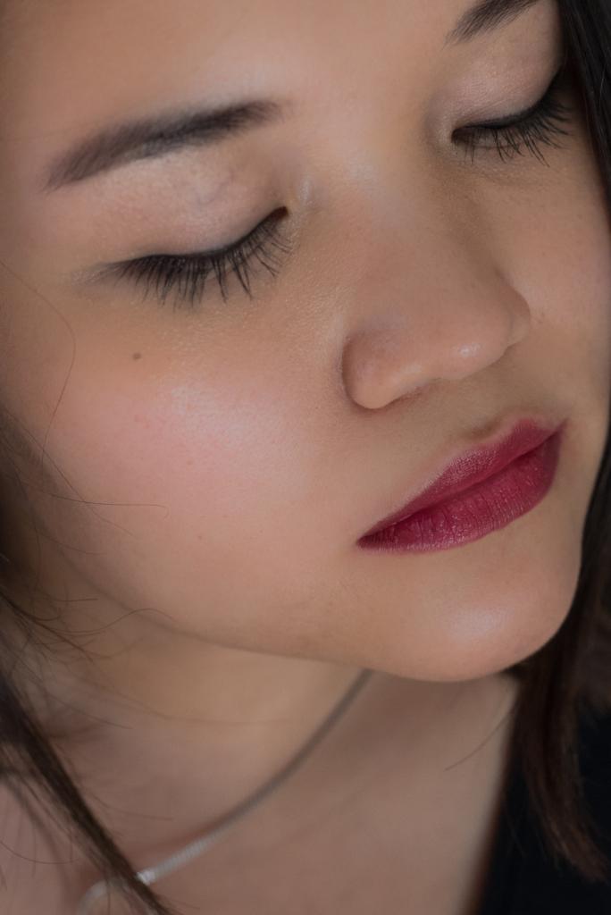 Claire Ketterer wearing Clarins 803 Plum Gradation Lipstick
