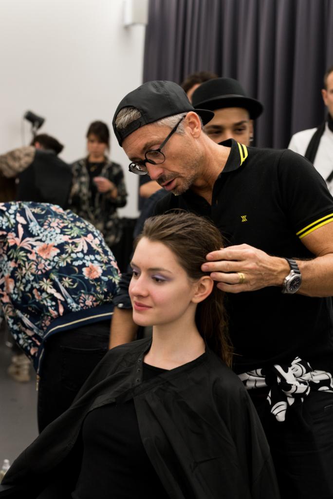 Christophe Durand preparing models for the HEAD 2018 fashion show